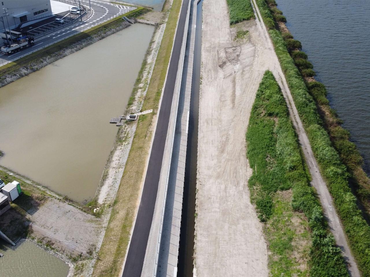 道路橋りょう改築工事地盤沈下対策河川緊急整備工事合併工事(諸桑工区)